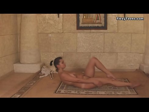 Young naked gymnast shows what she can do with her flexible body
