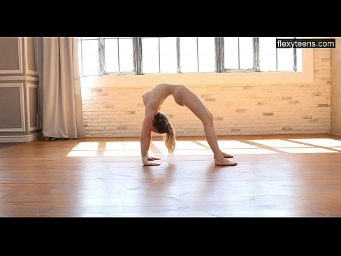 Hot young gymnast Emma shows off her flexible naked body