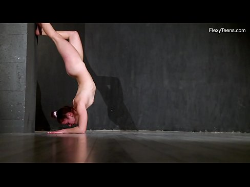 Young Karmen does naked gymnastics